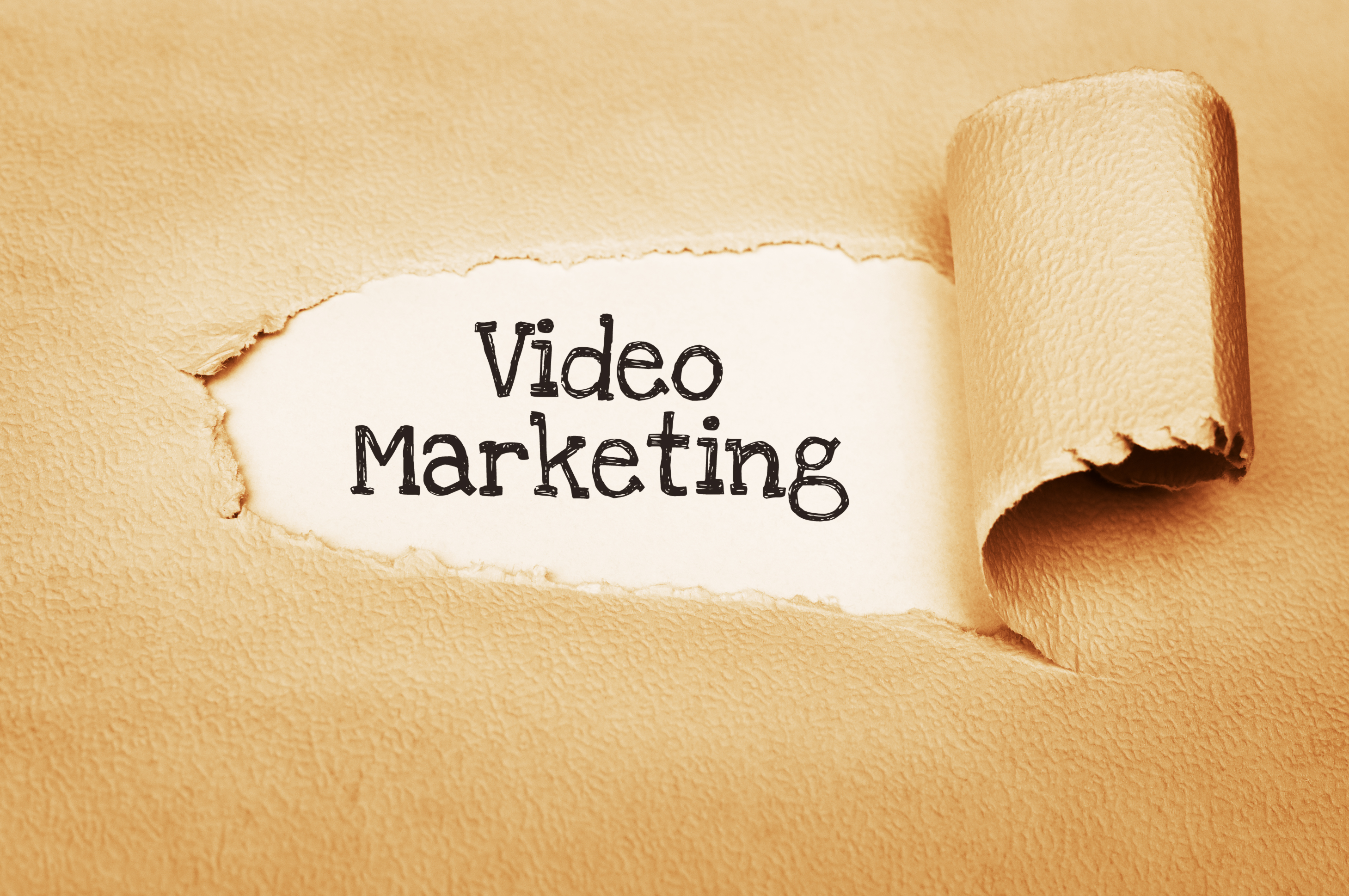 Video Marketing Concept. Written behind a torn paper